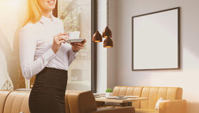Woman in a cafe with poster Royalty Free Stock Photos