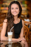 Woman in cafe Stock Images