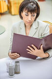 Woman cafe reading menu Royalty Free Stock Photos