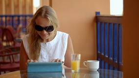 Woman in cafe with tablet PC stock video