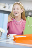 Woman in cafe taking break. From shopping having a coffee stock image