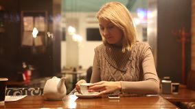 Woman cafe tayping message stock video