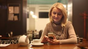 Woman cafe tayping message stock footage
