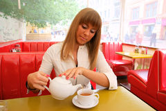 Woman in cafe with tea Royalty Free Stock Photos