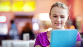 Woman in cafe using her touchpad stock video footage