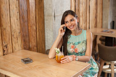 Woman in a cafe using mobile phone Stock Photos