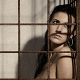 Woman in a cage Stock Image