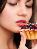 Woman and cake. Attractive black hair woman with a cake. Close-up studio portrait Royalty Free Stock Photography