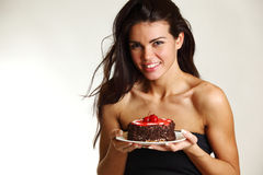 Woman and cake Stock Images