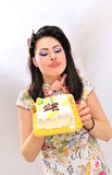 Woman with a cake Royalty Free Stock Image