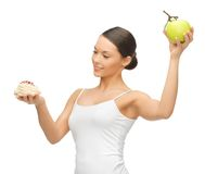 Woman with cake and apple Stock Image