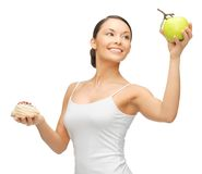 Woman with cake and apple Royalty Free Stock Photography