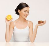 Woman with cake and orange Stock Photography