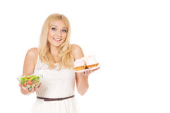 Woman with cake and vegetables Stock Images
