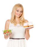Woman with cake and vegetables Royalty Free Stock Photo