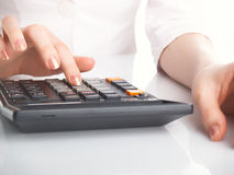 Woman with calculate stock image