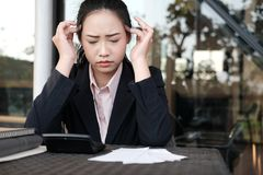 Woman calculate domestic bills at home. Businesswoman using calc Stock Photography