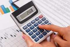 Woman calculate about expenses. At office stock photos