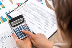 Woman calculate about expenses. At office stock image