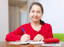 Woman is calculated the family budget Royalty Free Stock Photography