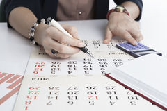 Woman calculates future plans Stock Photography