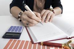 Woman calculates future plans Stock Photos