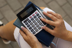 Woman calculating. Expenses at tax time royalty free stock photography