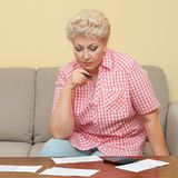 Woman calculating her debts Royalty Free Stock Image
