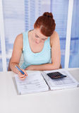 Woman Calculating Home Finances At Desk Royalty Free Stock Photos