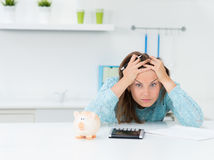 Woman calculating houshold costs Stock Photos