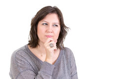 Woman with a calculating pensive look Stock Images