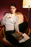 Woman with calculator Stock Image