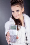 Woman with calculator in jewelery boxes Royalty Free Stock Images
