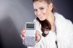 Woman with calculator in jewelery boxes Stock Photo