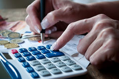 Woman with calculator and money Stock Photography