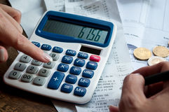 Woman with calculator and money Royalty Free Stock Photography