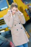 Woman caling autoservice because car problem. Woman caling autoservice because of car problem Stock Photo