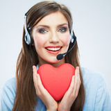 Woman call center operator hold love symbol Red heart. Close up Royalty Free Stock Photos