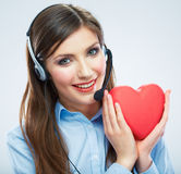 Woman call center operator hold love symbol Red heart. Close up Stock Photos