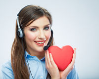 Woman call center operator hold love symbol Red he Stock Photo