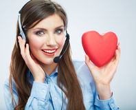 Woman call center operator hold love symbol Red heart. Close up Royalty Free Stock Image