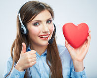 Woman call center operator hold love symbol Red heart. Close up Royalty Free Stock Photography