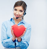 Woman call center operator hold love symbol of Valentine day. R Royalty Free Stock Image