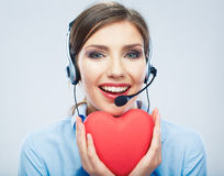 Woman call center operator hold love symbol of Valentine day. R Stock Photography