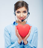 Woman call center operator hold love symbol of Valentine day. R Stock Photo