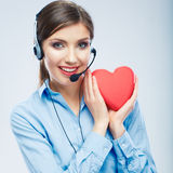 Woman call center operator hold love symbol of Valentine day. R Royalty Free Stock Photography