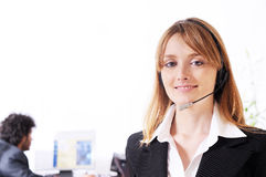 Woman and call centre. Smiling and look in camera Royalty Free Stock Photo