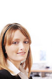 Woman and call centre. Woman with headphones and call centre,smiling and look in camera Royalty Free Stock Images