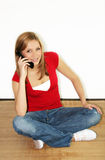 Woman is calling. A young woman is calling with her mobilephone Stock Photo