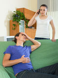 Woman calling an ambulance. For sick man Royalty Free Stock Images